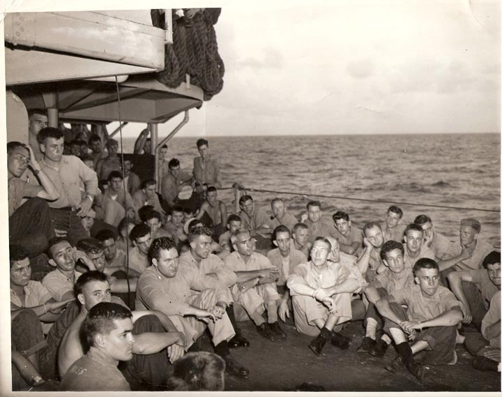 Unknown group sitting on deck