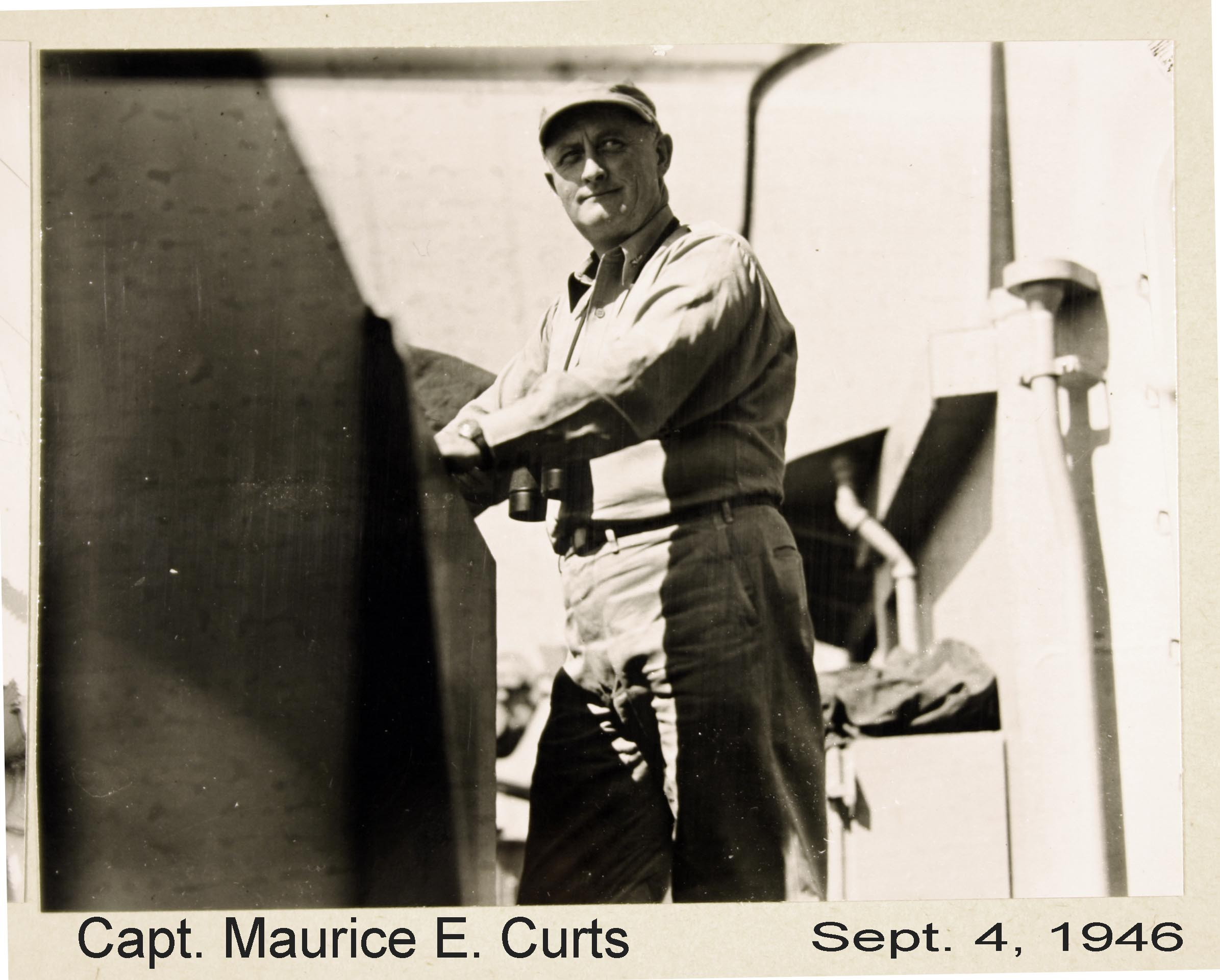 Captain Curts standing at railing